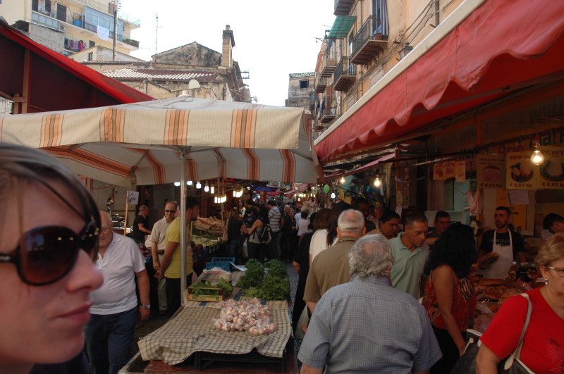 The street market on Via Ballaro.  Two worlds are separated horizontally by the line of canopies, each has its own disorderly order.  There's nothing too dressed up about the market, nothing much that's been through a design review.  The produce largely speaks for itself.