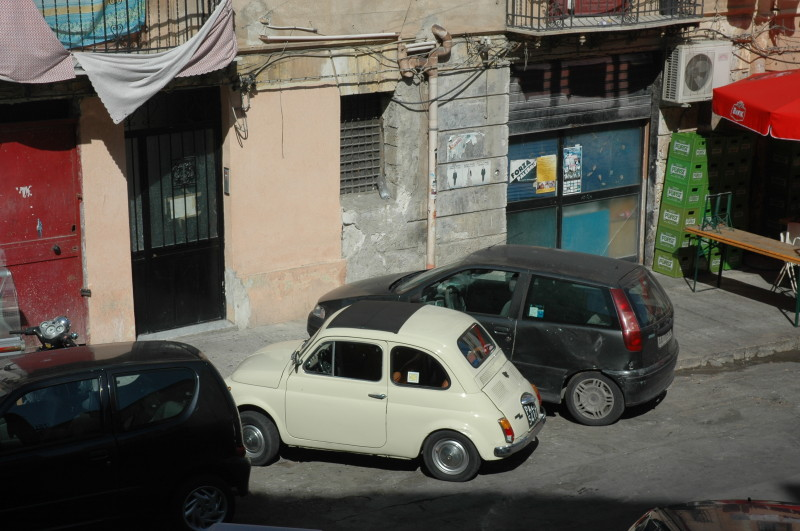 Note the contrast between the clean-ness of the Fiat 500 and the dirtiness, untidiness or ad-hocness of everything else.  Perhaps there are more important things to do than re-wiring these houses.  Via Nasi Nunzio opposite the Chiesa e Torre di San Nicolo all'Albergheria.
